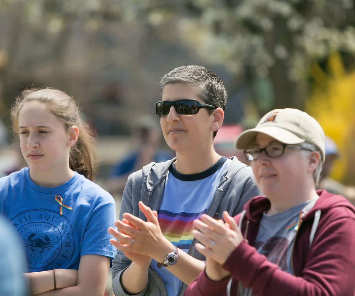 A crowd watches speakers at the Bethel CT Pride LGBTQ+ parade celebrating gay, trans, lesbian, genderqueer, intersex, transgender, queer, and human rights in northwestern Connecticut